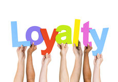 Diverse People Holding Word Loyalty Stock Image