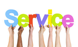 Diverse People Holding Word Service. Multi-Ethnic Group of Diverse People Holding Letters To Form A Service stock image