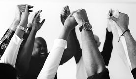 Diverse people joining hands together teamwork and winning concept royalty free stock photos
