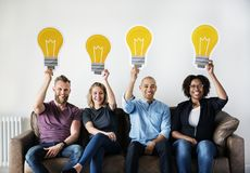 Diverse people with lightbulb icon Stock Images