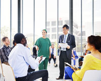 Diverse People Listening to the Doctor's Presentation Stock Photo
