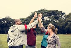 Diverse people making a high five royalty free stock image