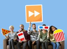 Group of diverse friends holding movie emoticons stock image