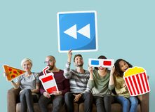 Diverse people with movie icons stock photography