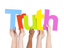 Diverse People's Hands Holding Word Truth.  Royalty Free Stock Image