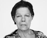 Diverse people shoot caucasian woman senior Stock Photo