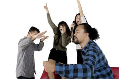 Diverse people singing karaoke. While dancing together, isolated on white background Royalty Free Stock Image