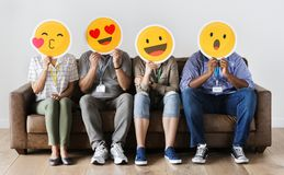 Diverse People Sitting And Covering Face With Emojis Boards Stock Image