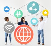 Diverse people with social media icons Royalty Free Stock Image