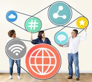 Diverse people with social media icons Stock Photography