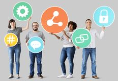 Diverse people with social media icons stock images