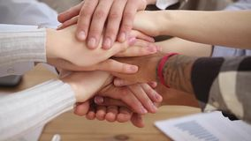 Diverse people student team stacking hands together in pile. Diverse people stacking hands together in pile, multi ethnic students sales team engaged in stock video footage