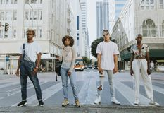 Diverse people standing on the street royalty free stock photography