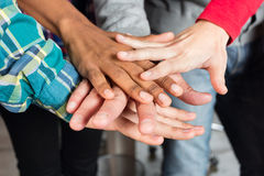 Diverse people team hands on top of each other support Royalty Free Stock Images