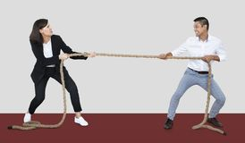 Diverse people tugging on a rope royalty free stock photo