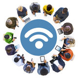 Diverse People Using Devices with Diverse Symbol. Diverse People Using Digital Devices with Diverse Symbol Stock Photo