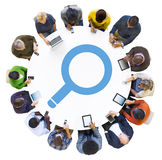 Diverse People Using Devices with Search Symbol. Diverse People Using Digital Devices with Search Symbol Royalty Free Stock Photography