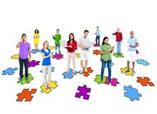 Diverse People Using Digital Devices with Jigsaw Pieces Stock Images