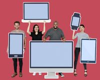 Diverse people with various mockup of digital devices stock images