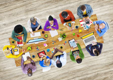 Diverse People Working in a Photo Illustrated Office Stock Photography