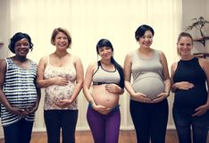 Diverse pregnant women in maternity class royalty free stock photos