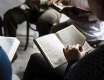 Diverse religious shoot. People reading bible Royalty Free Stock Image