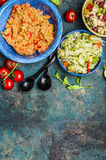 Diverse salads bowls on rustic background Royalty Free Stock Photo