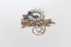 Diverse smycken på vit bakgrund Royaltyfria Bilder