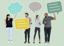 People holding colorful speech bubbles stock photos