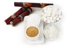 Diverse soorten suiker op wit Royalty-vrije Stock Afbeelding