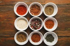 Diverse spices in small cups royalty free stock images