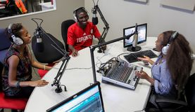 Diverse Students on College Campus Radio station. Johannesburg, South Africa, April 17, 2012, Diverse Students on College Campus Radio station royalty free stock photo