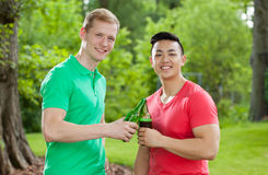 Diverse students drinking beer Stock Photography