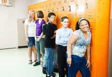 Diverse Students at Lockers. Diverse group of teenage students at their school lockers between classes stock photography