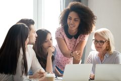 Diverse students workers team and mentor teacher involved in discussion. Diverse students workers interns team and mentor teacher coach involved in discussion royalty free stock photo