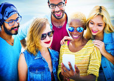 Diverse Summer Friends Fun Bonding Smart Phone Concept Royalty Free Stock Photography