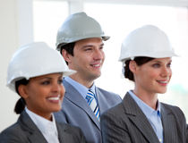 A diverse team of architects standing Royalty Free Stock Photo