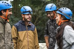 Diverse team building outdoor in the rain forest togetherness Stock Photography