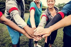 Diverse team stacking their hands royalty free stock photography