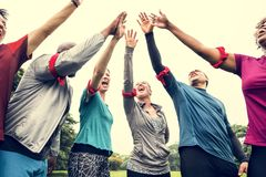 Diverse team stacking their hands royalty free stock photo