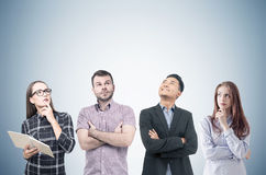 Diverse team of young business people with books Stock Photography