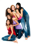 Diverse Teenagers. A group of teenagers with diverse ethnicities laugh and hold each other against white background Royalty Free Stock Image