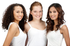 Diverse Teenagers. Three young and attractive teenagers with diverse ethnicities against white background Stock Image