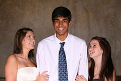 Diverse teens flirting. East indian teen boy and caucasian girls flirting Stock Photography