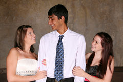 Diverse teens flirting. East indian teen boy and caucasian girls flirting Royalty Free Stock Photos