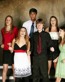 Diverse teens singing Stock Photo