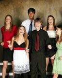 Diverse teens singing. Teens singing in choir in formal dress Stock Photo