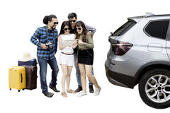 Diverse tourists with suitcases behind a car Stock Images