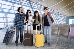 Diverse tourists with tablet in airport terminal Stock Images