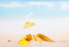 Diverse trash and rubber duck on  sea beach. Royalty Free Stock Photography